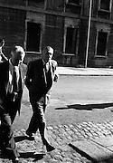 07/10/1959<br /> 10/07/1959<br /> 07 October 1959<br /> Hully case at the Four Courts.<br /> Mr Hully (left) leaving the Four Courts, Dublin.