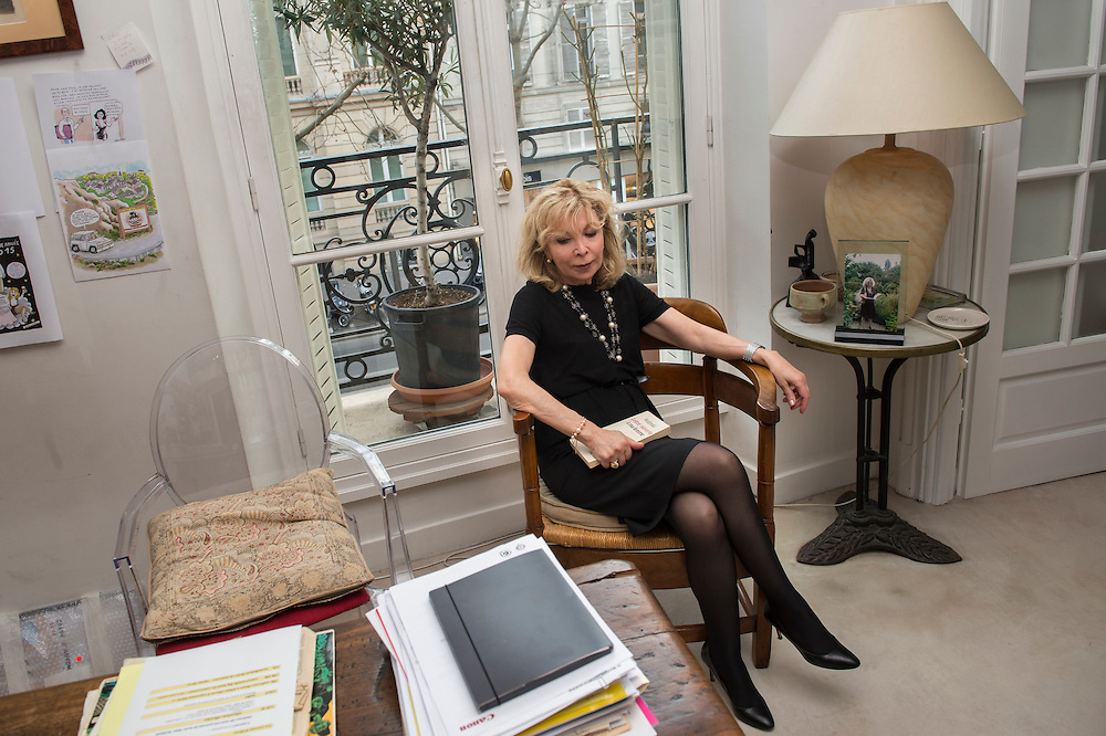 """March 11, 2015, Paris, France. Writer Maryse Wolinski (1943, Algiers) in the Paris' apartment where Georges and Maryse Wolinski used to live. Two month after the death of Georges Wolinski (1934 –2015), the apartment is full of souvenirs and notes, attesting a half-century-long love relation. In 2016 Maryse Wolinski published the book """"Chérie, je vais à Charlie"""" about her husband and the attack on Charlie Hebdo. The cartoonist Georges Wolinski was 80 years old when he was murdered by the French jihadists Chérif en Saïd Kouachi, he was one of the 12 victims of the massacre in the Charlie Hebdo offices on January 7, 2015 in Paris. Charlie Hebdo published caricatures of Mohammed, considered blasphemous by some Muslims. During his life, Georges Wolinski defended freedom, secularism and humour and was one of the major political cartoonists in France. The couple was married and had lived for 47 years together. Photo: Steven Wassenaar."""