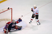 25 February 2002: MVP Joe Sakic of the NHL's Colorado Avalanche puts the puck in the net past goalie New York Rangers Mike Richter for Team Canada in the 2002 Winter Olympic Games in Salt Lake City, Utah.  Canada beat team USA 5-2.<br />