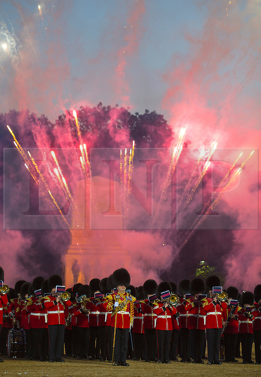 © London News Pictures. 10/06/2015. London, UK. A fireworks display during the ceremony. Waterloo 200 themed open air Beating Retreat, performed on Horseguards Parade in London. Photo credit: Sergeant Rupert Frere/LNP
