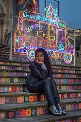 © Licensed to London News Pictures. 13/11/2020. LONDON, UK. British artist Chila Kumari Singh Burman poses in front of her new Winter Commission which has been unveiled at Tate Britain.  Her installation on the façade references mythology, Bollywood, radical feminism, political activism and family memories in a celebration of neon light and swirling colour and is on display until 31 January 2021.  Photo credit: Stephen Chung/LNP