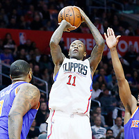 11 March 2016: Los Angeles Clippers guard Jamal Crawford (11) takes a jump shot over New York Knicks forward Kyle O'Quinn (9) and New York Knicks guard Langston Galloway (2) during the LA Clippers 101-94 victory over the New York Knicks, at the Staples Center, Los Angeles, California, USA.