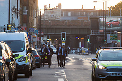 "Finsbury Park, London, June 19th 2017. A major police and emergency services operation with firearms officers in attendance is underway near Finsbury Park Mosque following reports of Several people being injured after a van struck a crowd of pedestrians near a north London mosque in what police have called a ""major incident"". PICTURED: Detectives walk towards the scene."