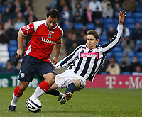 Photo: Steve Bond/Sportsbeat Images.<br /> West Bromwich Albion v Charlton Athletic. Coca Cola Championship. 15/12/2007. Andy Reid (L) is tackled by Zoltan Gera (R)