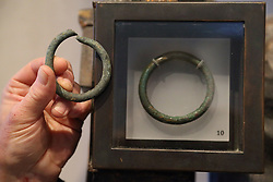 Iron ring dug up in  Orkney and Iron Age ring in Edinburgh Museum.