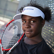 Venus and Serena Williams grew up playing on the public, park courts in Compton, CA. Although some courts where they played remain, they are normally locked to keep gang members from congregating and are strewn with weeds and trash. Other courts, like those at Wilson Park, have since been demolished and replaced with new jungle gyms and a skate park. Lueders Park now has courts that cater to the next generation of Compton tennis players with free clinics. Portrait of Kiaira Lewis