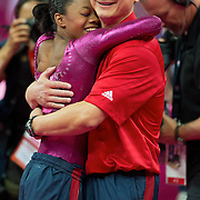 Gabrielle Douglas of the United States, left, hugged her coach Liang Chow, right, at the conclusion of the last rotation that clinched her gold medal in the women's gymnastics individual all-around finals at North Greenwich Arena during the 2012 Summer Olympic Games in London, England, Thursday, August 2, 2012. (David Eulitt/Kansas City Star/MCT)