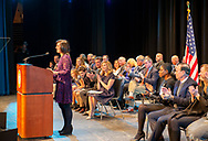 Hempstead, NY, U.S. January 1, 2018. SYLVIA CABANA speaks at podium after being sworn in as the first Latin women Hempstead Town Clerk. LAURA GILLEN, just sworn in as Hempstead Town Supervisor, sits in left aisle seat of front row, at Hofstra University.