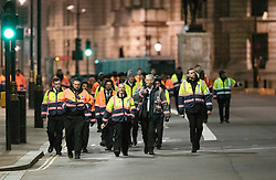 © Licensed to London News Pictures. 31/12/2018. London, UK. Event security personnel walk along an empty Whitehall before the crowds arrive to celebrate New Year's Eve in central London.  Over 100,000 people are attending London's ticketed fireworks display on the banks of the River Thames for New Year's Eve tonight. Photo credit: Peter Macdiarmid/LNP