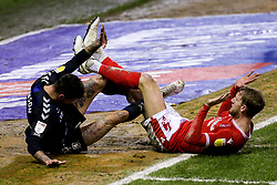 Joe Worrall of Nottingham Forest and Marvin Johnson of Middlesbrough tangle their legs - Mandatory by-line: Robbie Stephenson/JMP - 20/01/2021 - FOOTBALL - City Ground - Nottingham, England - Nottingham Forest v Middlesbrough - Sky Bet Championship