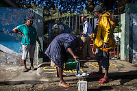 Anse La Raye, Saint Lucia: Fishermen sell part of the catch to the local school.