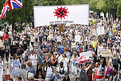 © Licensed to London News Pictures. 26/06/2021. London, UK. Anti-lockdown protesters in Hyde march through central London. Various groups are marching in central London today calling for freedom and an end to lockdown regulations. Photo credit: Peter Macdiarmid/LNP