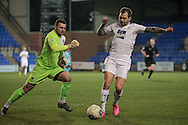 James Norwood (Tranmere Rovers) gets around the Boreham Wood keeper, Grant Smith (Boreham Wood) and sets up a shooting chance with the goal open during the Vanarama National League match between Tranmere Rovers and Boreham Wood at Prenton Park, Birkenhead, England on 21 February 2017. Photo by Mark P Doherty.