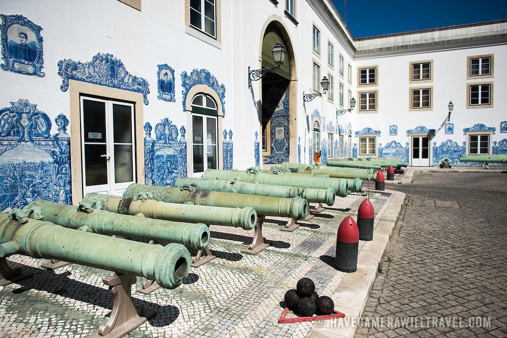LISBON, Portugal - The courtyard of the Museu Militar in Lisbon is lined with cannons. The blue and white tiles lining the walls depict the history of Portugal. Housed in the old armoury, Lisbon's Military Museum showcases 500 years of Portuguese military history, with many of the exhibits in opulently decorated rooms of the historic building.