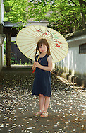 Little girl holding a parasol photographed by Vacaville portrait photographer Kristina Cilia