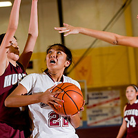 022513     Brian Leddy<br /> Rehoboth Lynx Tia Yazzie (22) looks for the basket while being tightly guarded by Ramah Mustang Jordyn Lewis (3) during Monday night's district playoff game
