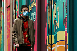 © Licensed to London News Pictures. 15/03/2020. London, UK. A man wearing a protective face mask amid an increased number of Coronavirus (COVID-19) cases in the UK. 21 coronavirus victims have died and 820 cases have tested positive for the virus in the UK. 167 people across London have tested positive for the virus. Photo credit: Dinendra Haria/LNP