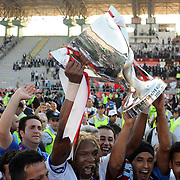 Jubilant Trabzonspor players Rigobert Song BAHANAG (C) lifting up the cup at the ceremony during their after the Turkey Cup final match Trabzonspor between Fenerbahce at the GAP Arena Stadium at Urfa Turkey on wednesday, 05 May 2010. Photo by TURKPIX
