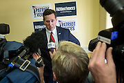 Former U.S. Senator Rick Santorum speaks to local media after addressing the South Carolina National Security Action Summit on March 14, 2015 in West Columbia, South Carolina.