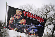 Supporters of U.S. President Donald Trump fly a flag outside a site for Trump's rally taking place the next day, in Des Moines, Iowa, U.S., January 29, 2020. REUTERS/Rick Wilking