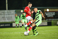 Forest Green Rovers David Pipe battles for the ball with Bristol City's Jack Batten during the The County Cup match between Forest Green Rovers and Bristol City at the New Lawn, Forest Green, United Kingdom on 23 November 2015. Photo by Shane Healey.