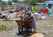Seamstress with manual sewing machine awaits customers at the Frontier Market, Tanzania