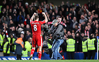 Liverpool skipper steven Gerrard celebrates the win in fornt of the travelling Kop<br />FA Barclays Premiership. Chelsea v Liverpool. 06.02.11<br />Photo By Karl Winter Fotosports International