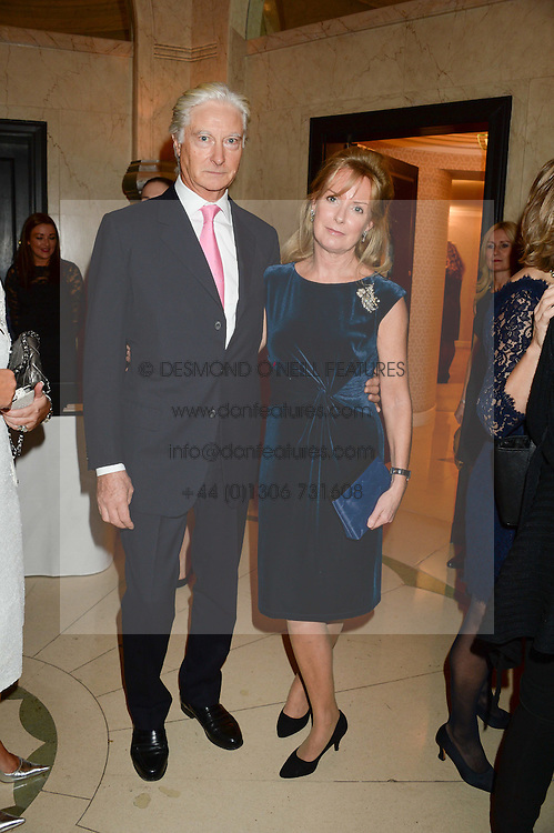 """PRINCE NICHOLAS VON PREUSSEN and SARAH MACMILLAN at an """"Evening With Damon Hill'  a dinner and talk in aid of the Downs Syndrome Association held at Claridge's, Brook Street, London on 7th November 2013."""