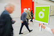 Shareholders arrive. Environmental protestors outside the BP AGM at the Excel Centre. They are highlighting the dangers of deep sea drilling and the damage to the Gulf. As well as being anti tar sands oil and the general impact of burning fossil fuels on the environment.