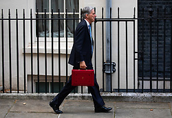 © Licensed to London News Pictures. 29/10/2018. London, UK. Chancellor of the Exchequer Philip Hammond holds his red ministerial box outside 11 Downing Street as part of a photocall on the autumn budget statement day. Photo credit : Tom Nicholson/LNP