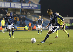 Millwall's Simeon Jackson scores from the penalty spot after being brought down by Birmingham City's Aaron Martin - Photo mandatory by-line: Robin White/JMP - Tel: Mobile: 07966 386802 15/03/2014 - SPORT - FOOTBALL - The Den - Millwall - Millwall v Birmingham City - Sky Bet Championship
