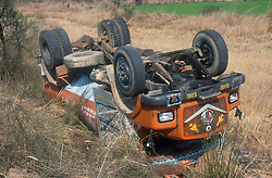 Road accident in India; with overturned lorry by road side,