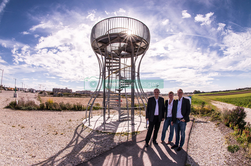 October 6, 2018 - Munich, Bavaria, Germany - CHRISTIAN MUELLER, Munich city councilman, FLORIAN RITTER of the Bavarian Landtag, Katja Weitzel, district representative, and Berlin mayor MICHAEL MUELLER stand next to a platform in Munich's Freiham district. In support of the Bavarian SPD, Berlin Mayor Michael Mueller visited the Freiham district of Munich to view the large construction project that will bring tens of thousands of jobs and living units to the edge of the city's western boundary.  Hosting Mueller were Florian Ritter of the Bavarian SPD in the Landtag, Christian Mueller, city councilman, and district councilor Katja Weitzel.  The Bavarian state elections will take place on October 14th and have gained national attention due to the Bavarian CSU gaining a federal role through Horst Seehofer.  A core platform of the SPD is that of affordable housing..Mueller is furthermore President of the Bundesrat, which gives him the additional role of deputy to the German President. (Credit Image: © Sachelle Babbar/ZUMA Wire)