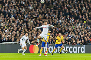 Tottenham Hotspur midfielder Dele Alli heads the ball during the Champions League match between Tottenham Hotspur and Juventus FC at Wembley Stadium, London, England on 7 March 2018. Picture by Toyin Oshodi.
