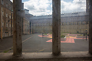 A view through a window of the prison the exercise yard from inside the jail at HMP Wandsworth, London, United Kingdom. HMP Wandsworth in South West London was built in 1851 and is one of the largest prisons in Western Europe. It has a capacity of 1456 prisoners. (Picture by Andy Aitchison)