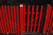 Red picket fence in front of weekend cottages. Copenhagen, Denmark.