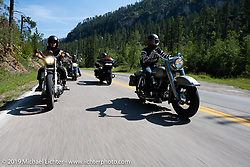 Lance and Tiffany head up the Knight family riding together on the Cycle Source annual ride to the hills during the Sturgis Motorcycle Rally. SD, USA. Wednesday, August 11, 2021. Photography ©2021 Michael Lichter.