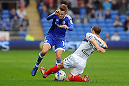 Cardiff City's Craig Noone is tackled strongly by Wigan's Stephen Warnock (r). EFL Skybet championship match, Cardiff city v Wigan Athletic at the Cardiff city stadium in Cardiff, South Wales on Saturday 29th October 2016.<br /> pic by Carl Robertson, Andrew Orchard sports photography.