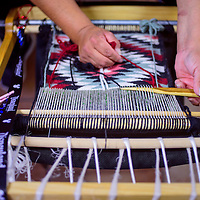 042815       Cable Hoover<br /> <br /> Candice Craig weaves a pattern into her rug during a weaving class at Navajo Technical University in Crownpoint Tuesday.