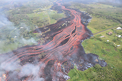 Handout photo taken on May 19, 2018. KÄ«lauea Volcano — Channelized Lava Flow. Helicopter overflight of KÄ«lauea Volcano's lower East Rift zone on May 19, 2018, around 8:18 AM, HST. 'A'ā lava flows emerging from the elongated fissure 16-20 form channels. The flow direction in this picture is from upper center to the lower left. Photo by usgs via ABACAPRESS.COM