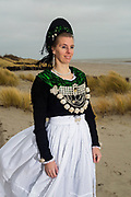 Kerstin, member of a Folklore Association of the island of Föhr is wearing an original traditional bridal costume on Föhr, Schleswig Holstein, Germany on December 9, 2016.<br /> <br /> Kerstin has made the white apron herself, but from dress to jewelry, adornments and blouse, everything else is heirloom of her grandmother and great grandmother. She has worn this dress to her wedding and she is still wearing the dress about twice a week.<br /> <br /> This is part of the series about Traditional Wedding Gowns from different regions of Germany, worn by young members of local dance groups and cultural associations that exist to preserve and celebrate the cultural heritage. The portraiture series is a depiction of an old era with different social values and religious beliefs in an antiquated civil society with very few of those dresses left.