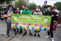 London, UK. 26th June, 2021. Supporters of LGBTIQA+ Greens show solidarity with thousands of people assembling to take part in a London Trans+ Pride march from the Wellington Arch to Soho Square. London Trans+ Pride is a grassroots protest event which is not affiliated with Pride in London and focuses on creating a space for the London trans, non-binary, intersex and GNC community to come together to celebrate their identities and to fight for their rights.