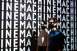 © Licensed to London News Pictures. 28/07/2020. London, UK. Design Museum staff member pose in front of a Kraftwerk 3d video installation on display at The Design Museum exhibition 'Electronic: From Kraftwerk to The Chemical Brothers'. The exhibition explores the hypnotic world of electronic music and discovers its global impact from underground movements to the mainstream  and features appearances from the likes of Jeff Mills, Ellen Allien, Jean-Michel Jarre and more. It will also feature a 3-D experience surrounding electronic pioneers Kraftwerk, with the installation soundtracked by legendary DJ and producer, Laurent Garnier. Photo credit: Ray Tang/LNP