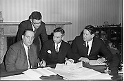 New Industrial Development At Bunbeg, Donegal..1968..30.01.1968..01.30.1968..30th January 1968..At a press conference at Gaeltarra Éireann,Dublin today, an announcement was made of a major new industrial development at Bunbeg, Co Donegal. An agreement was signed for the establishment of a company, Ambler of Donegal Ltd,for the production of fancy and loop yarns for the weaving industry. the company is a subsidiary of Jeremiah Ambler Limited of Bradford, Yorkshire...Image shows (L-R), Mr Padraig Ó Fachtna, Parliamentary Secretary to the Minister for the Gaeltacht; Mr Ivor Kenny, Chairman, Gaeltarra Éireann  and Mr F J Croft, Director, Jeremiah Ambler Ltd. Standing is Mr Cathal Mac Gabhann,General Manager, Gaeltarra Éireann at the signing of the agreement...