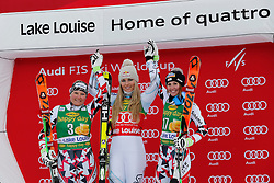 06.12.2015, East Summit Course, Lake Luise, CAN, FIS Weltcup Ski Alpin, Lake Luise, Damen, SuperG, im Bild v.l. Tamara Tippler (AUT, 2. Platz), Lindsey Vonn (USA, 1. Platz), Cornelia Huetter (AUT, 3. Platz) // 2nd placed Tamara Tippler of Austria ( L ), winner Lindsey Vonn of the USA ( C ), 3rd placed Cornelia Huetter of Austria ( R ) celebrate on podium during the race of ladies Super G of the Lake Luise FIS Ski Alpine World Cup at the East Summit Course in Lake Luise, Canada on 2015/12/06. EXPA Pictures © 2015, PhotoCredit: EXPA/ SM<br /> <br /> *****ATTENTION - OUT of GER*****
