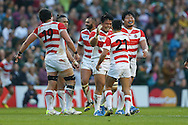 Japan players celebrate their win during the Rugby World Cup Pool B match between South Africa and Japan at the Community Stadium, Brighton and Hove, England on 19 September 2015. Photo by Phil Duncan.