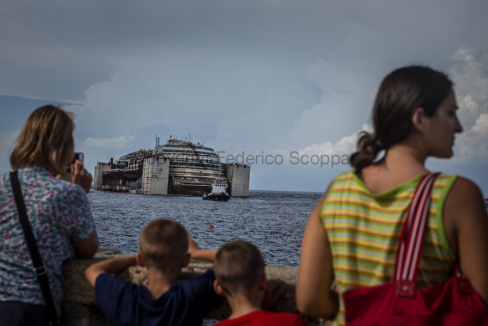 Turist looking at the Costa Concordia almost re floated