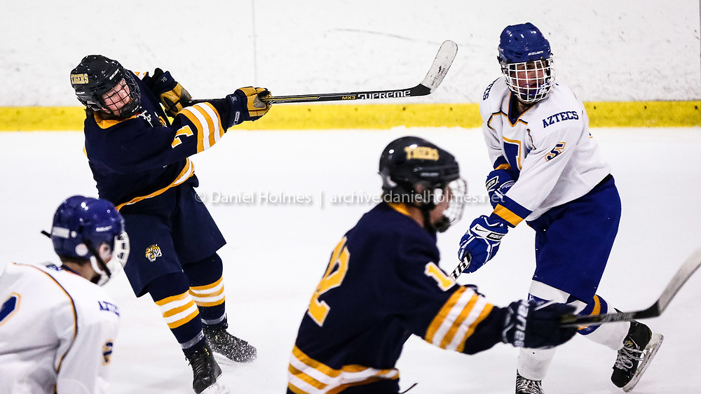 (1/25/16, MARLBOROUGH, MA) Littleton's Dmitri Dutkewych takes a shot that is deflected during the boys hockey game against Assabet-Maynard at New England Sports Center in Marlborough on Monday. Daily News and Wicked Local Photo/Dan Holmes