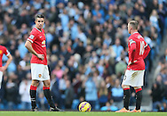 Robin van Persie of Manchester United and Wayne Rooney of Manchester United dejected following City's first goal - Barclays Premier League - Manchester City vs Manchester Utd - Etihad Stadium - Manchester - England - 2nd November 2014  - Picture David Klein/Sportimage