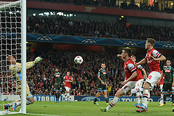 LONDON, ENGLAND - Oct 01: Napoli's goalkeeper Pepe Reina from Spain makes a save from Arsenal's defender Laurent Koscielny from France   during the UEFA Champions League match between Arsenal from England and Napoli from Italy played at The Emirates Stadium, on October 01, 2013 in London, England. (Photo by Mitchell Gunn/ESPA)